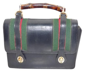 Gucci Mint Vintage Dressy Or Casual Early Style Lunchbox Style Highly Collectible Satchel in black leather & bamboo handle with red & green striped fabric