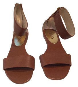 MICHAEL Michael Kors Brown with gold zipper back Sandals
