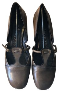Pedro Garcia Olive/brown, black trim, white stitching. Pumps