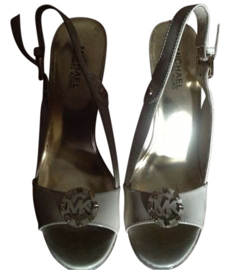 Preload https://item2.tradesy.com/images/michael-kors-leather-uppers-rubber-sole-wedges-size-us-95-197341-0-0.jpg?width=440&height=440