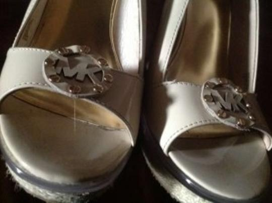 Michael Kors Has A Clear Glass Like Lining Around The Entire Upper Sole Of The This Adds Individuality To The The Famous And Much Wedges