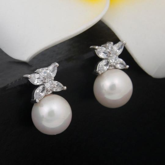 Clear Cz/Pearl and Rhodium Outstanding Quality Aaaaa Earrings Image 2