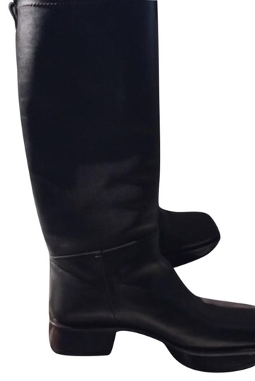 Preload https://img-static.tradesy.com/item/19745395/prada-dark-brown-bootsbooties-size-us-65-regular-m-b-0-1-540-540.jpg