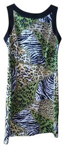 Ronni Nicole short dress Green animal print with black trim on Tradesy