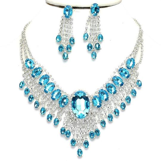 Preload https://item5.tradesy.com/images/blue-clear-crystal-elegant-design-silver-aqua-bib-collar-drop-dangle-earring-set-necklace-1974884-0-0.jpg?width=440&height=440