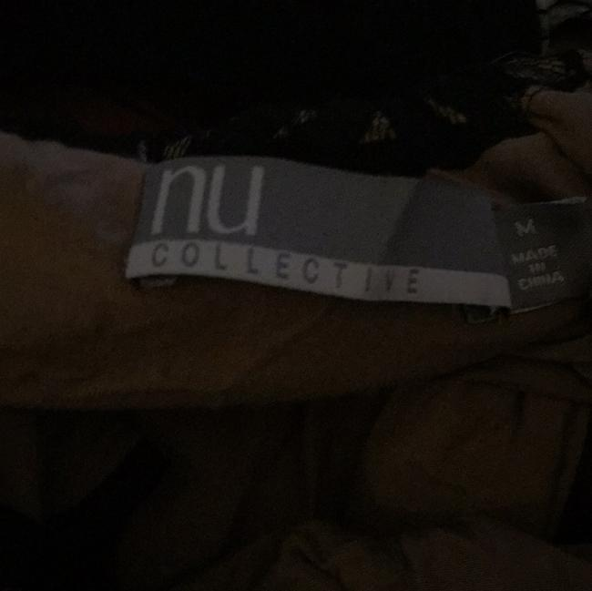 Nu Collective Top Image 3