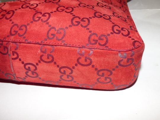 Gucci Suede/Leather Bucket/Satchel Style Chrome Wire Strap Excellent Condition Attached Wallet Satchel in red suede & leather with embossed large G print