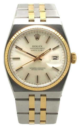 Preload https://item5.tradesy.com/images/rolex-steel-yellow-gold-black-17013-datejust-18k-bezel-stainless-mens-quartz-watch-1975579-0-2.jpg?width=440&height=440