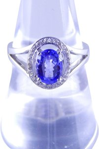 ELEGANT AND SIMPLE OVAL TANZANITE RING WITH SINGLE ROW OF DIAMONDS
