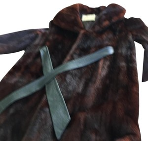 Long Fur coat, has Evelyn J Tinker sowed to the linning and has a The Broadway lable. It is 39 inches long and 23 inches wide. Leather belt is included. Fur Coat