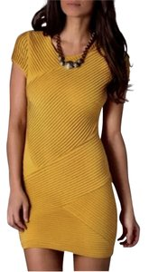 Torn by Ronny Kobo short dress Yellow gold on Tradesy