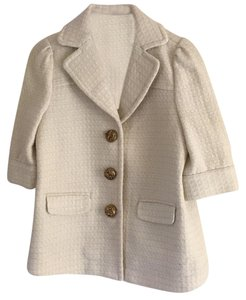 Juicy Couture Ivory with slight sparkle. Gold buttons. very fitted Blazer