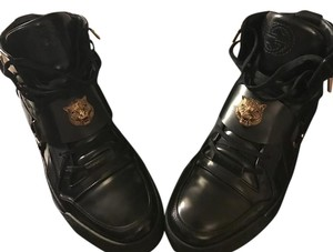 Gucci Black and Gold Boots