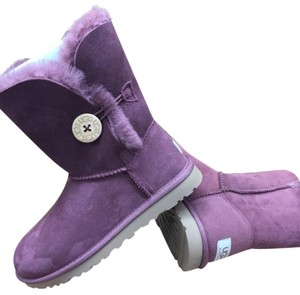 Bailey button plum/wine model #5803 reg $170 now $ 130 size 5 and 9 Plum/ wine Boots
