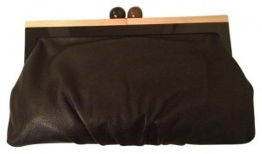 Preload https://img-static.tradesy.com/item/19798/kate-spade-unique-with-frame-black-and-brown-leather-wood-clutch-0-0-540-540.jpg