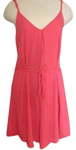 Francesca's short dress Pink, Coral Criss Cross Tie Waist Spaghetti Strap Coral Shift on Tradesy