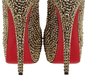 Christian Louboutin Gold, red Platforms