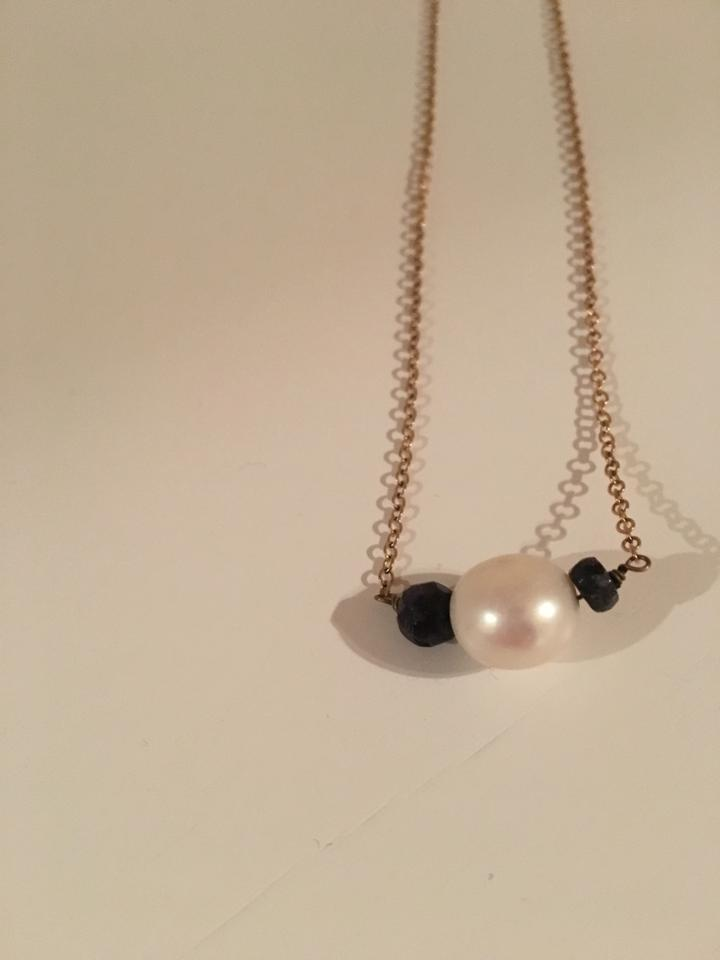 Gold chain white pearl with two blackblue stones on either side gold chain white pearl with two blackblue stones on either side pendant necklace mozeypictures Choice Image