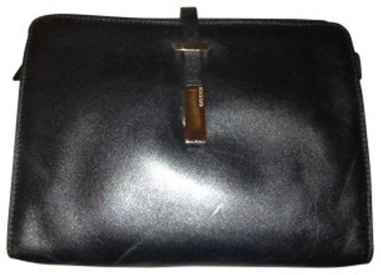 Preload https://img-static.tradesy.com/item/19808/gucci-smooth-simple-black-leather-clutch-0-0-540-540.jpg