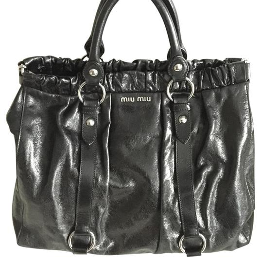 Preload https://img-static.tradesy.com/item/19810141/miu-miu-vitello-lux-gathered-tote-black-leather-satchel-0-1-540-540.jpg