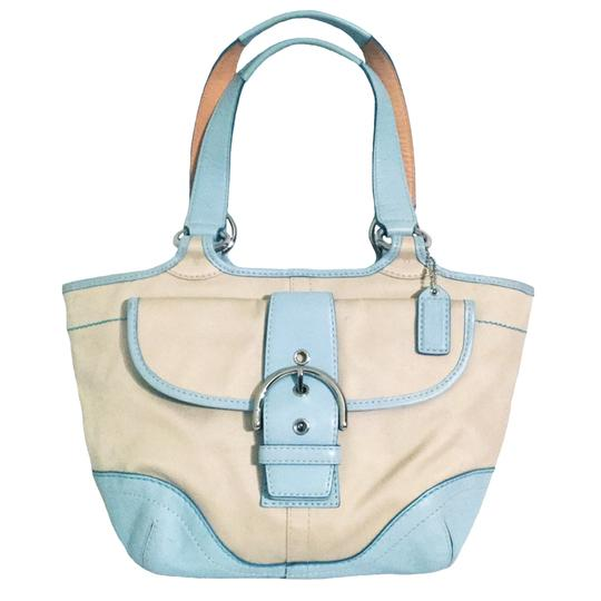 Preload https://item2.tradesy.com/images/coach-soho-twill-bucket-tote-blue-1882-beige-canvas-and-leather-shoulder-bag-19812006-0-5.jpg?width=440&height=440