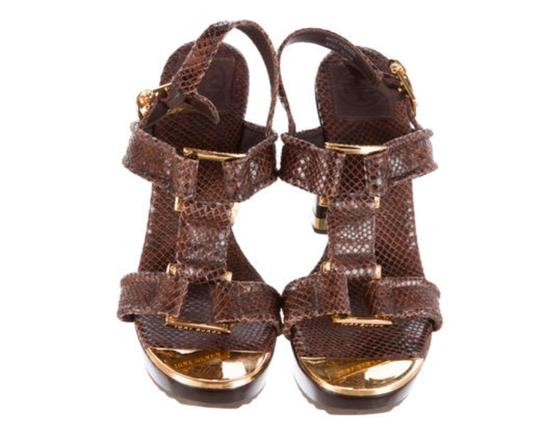 Preload https://item1.tradesy.com/images/tory-burch-brown-embossed-leather-round-toe-sandals-size-us-85-regular-m-b-19813405-0-0.jpg?width=440&height=440