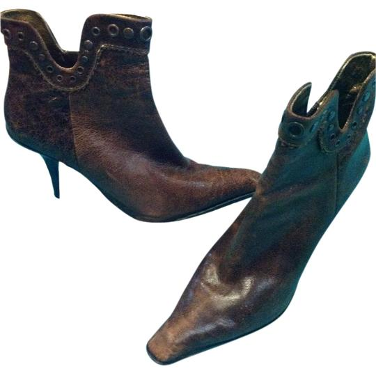 Preload https://item1.tradesy.com/images/nine-west-brown-the-leather-is-made-to-look-antique-bootsbooties-size-us-75-regular-m-b-19814060-0-1.jpg?width=440&height=440