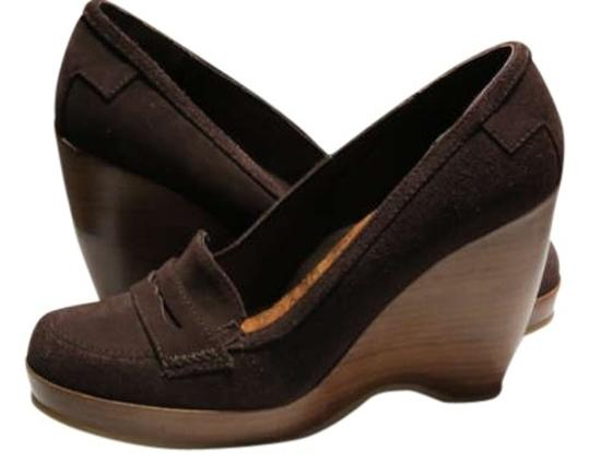 Preload https://img-static.tradesy.com/item/198220/on-your-feet-dark-brown-never-worn-wedges-size-us-75-0-0-540-540.jpg