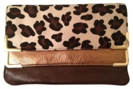 Preload https://item4.tradesy.com/images/michael-kors-unique-dual-gold-brown-and-animal-hair-and-leather-clutch-19823-0-0.jpg?width=440&height=440