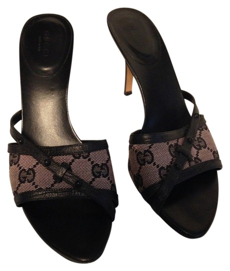Preload https://item2.tradesy.com/images/gucci-blackdusty-rose-slides-in-leather-and-gg-monogram-canvas-sandals-size-us-75-regular-m-b-1982626-0-0.jpg?width=440&height=440