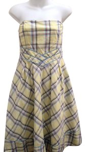 Maeve short dress Yellow Strapless Empire Waist Fit & Flare Plaid on Tradesy
