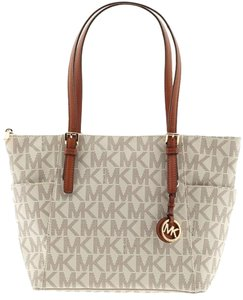 1567ceb05cc3 Added to Shopping Bag. Michael Kors Tote in VANILLA. Michael Kors Jet Set  East West Top Zip Mk Signature ...