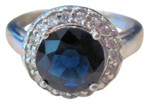 2.45 CTw Blue Sapphire 8 mm 0.26 CTw RD White Diamond Halo Ring