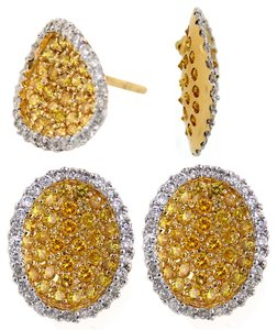 ABC Jewelry One pair of diamond earrings with a oval shape containing 120 round diamonds of white and a yellow color weighing a total of 1.51 carats