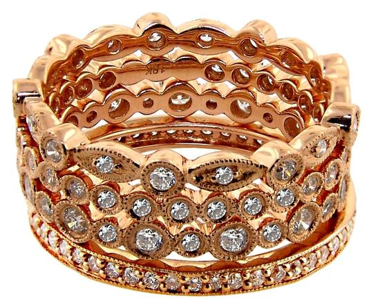 ABC Jewelry Rose gold 4 eternity band rings. The bands are mede of fine 18 karat rose gold and 2 millimeters each. There are 124 round cut diamonds weighing 1.14 total weight. the rings are a size 6 now and cannot be sized.
