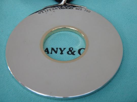 Tiffany & Co. sterling silver and 18k gold round pendant with silk cord Image 1