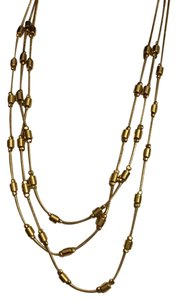 MONET Monet Triple Strand Gold Tone Necklace