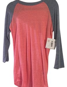 LuLaRoe T Shirt Heathered pink and blue/grey sleeves