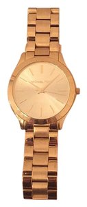 Michael Kors Slim Runway Gold Stainless Watch. Sized to small wrist.