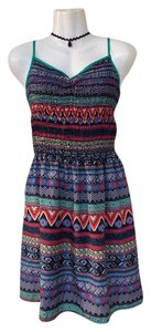 Xhilaration short dress green, blue, yellow, orange, red Aztec Chevron V-neck Stretchy on Tradesy