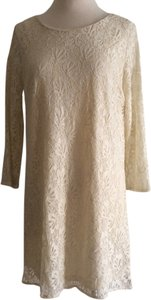 Xai short dress cream Lace Tunic on Tradesy