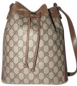 Gucci Drawstring Red/Green Excellent Vintage Bucket Satchel in brown in large G logo print coated canvas and brown leather with red and green accents