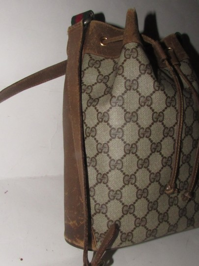 Gucci Drawstring Red/Green Excellent Vintage Bucket Satchel in brown in large G logo print coated canvas and brown leather with red and green accents Image 1