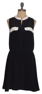 The Letter short dress BLACK Silk Pleated on Tradesy