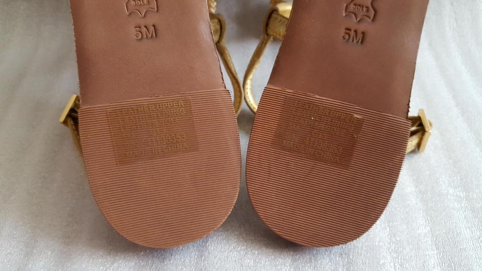 e11c97829eb0 ... Tory Burch Thong Bryn Pave Bow Leather Metallic Gold Sandals. 12345678  most popular 35631 e05cd ...