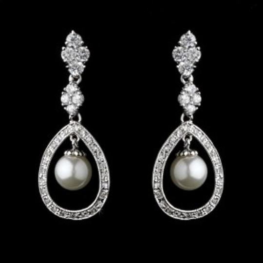 Preload https://item5.tradesy.com/images/elegance-by-carbonneau-silver-cz-and-pearl-drop-earrings-198654-0-0.jpg?width=440&height=440