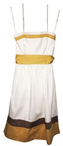 BCBG Paris short dress White Strapless Tea Length Empire Waist on Tradesy
