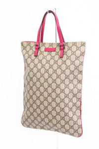 Gucci Monogram Coated Canvas Tote in Brown