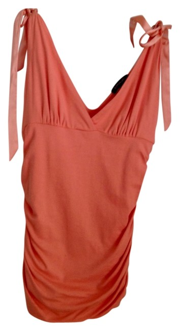 Preload https://item3.tradesy.com/images/coral-night-out-top-size-8-m-1987177-0-0.jpg?width=400&height=650
