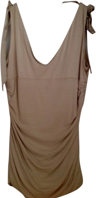 Preload https://item2.tradesy.com/images/bebe-beige-night-out-top-size-8-m-1987186-0-0.jpg?width=400&height=650